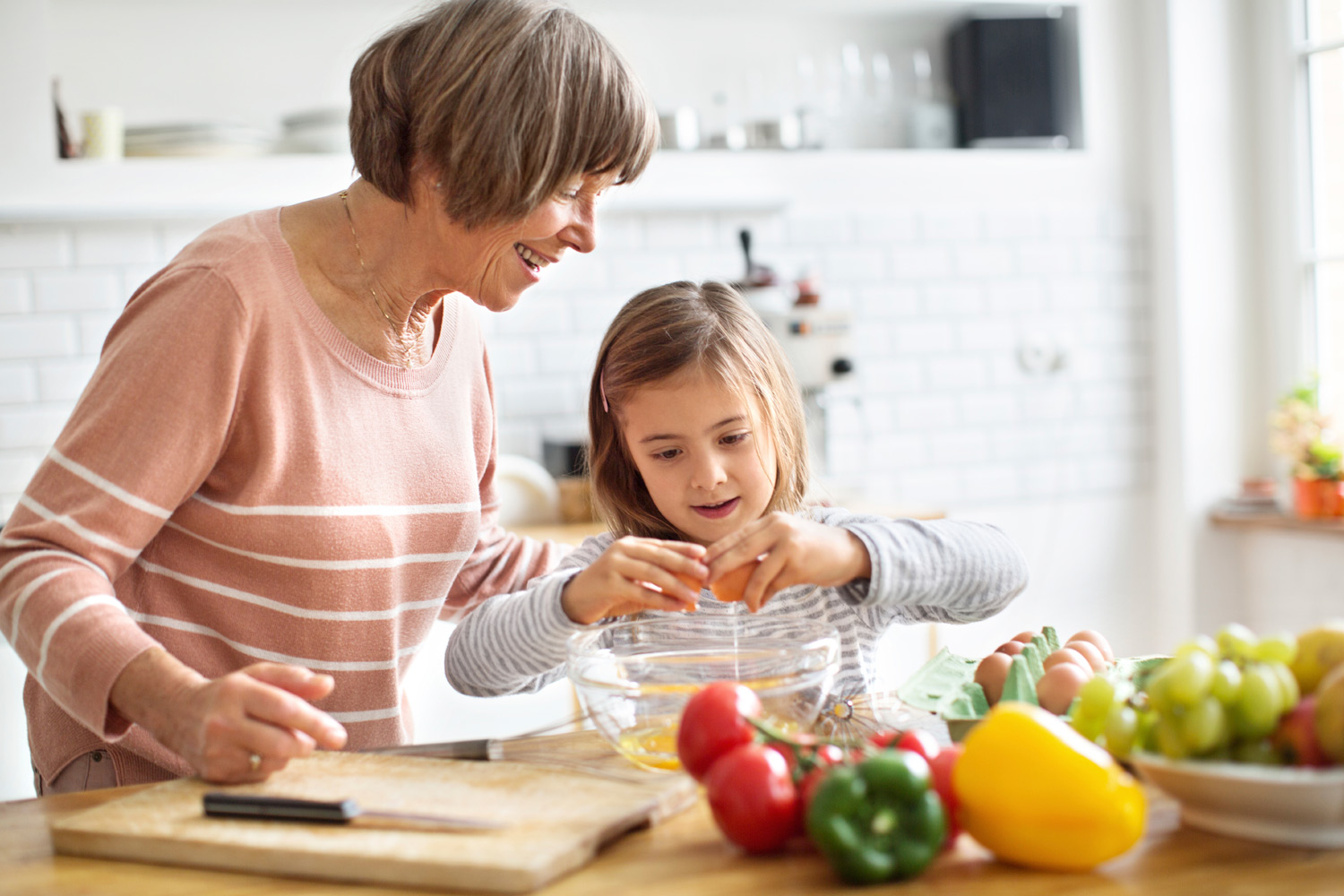 Photo - Grandmother and Grandchild cooking together