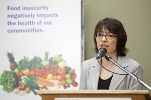 Graphic - photo - Dr. Patricia Williams speaks about the findings from the 2010 report on Food Costing.