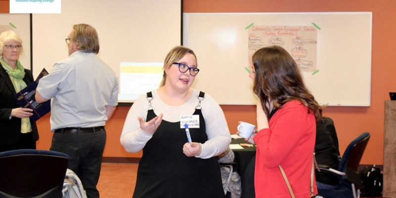 Participants discussing experiences in Community-Campus Engagement