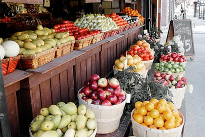 Photo - Grocery store with baskets full of fruit and vegetables.