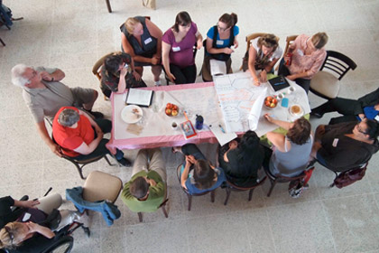 Photo - Community members and stakeholders sitting at the table together finding solutions.