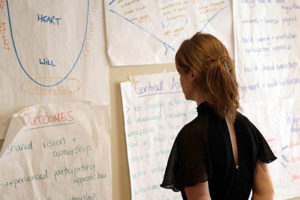 Photo - Women looking at data and discussions.